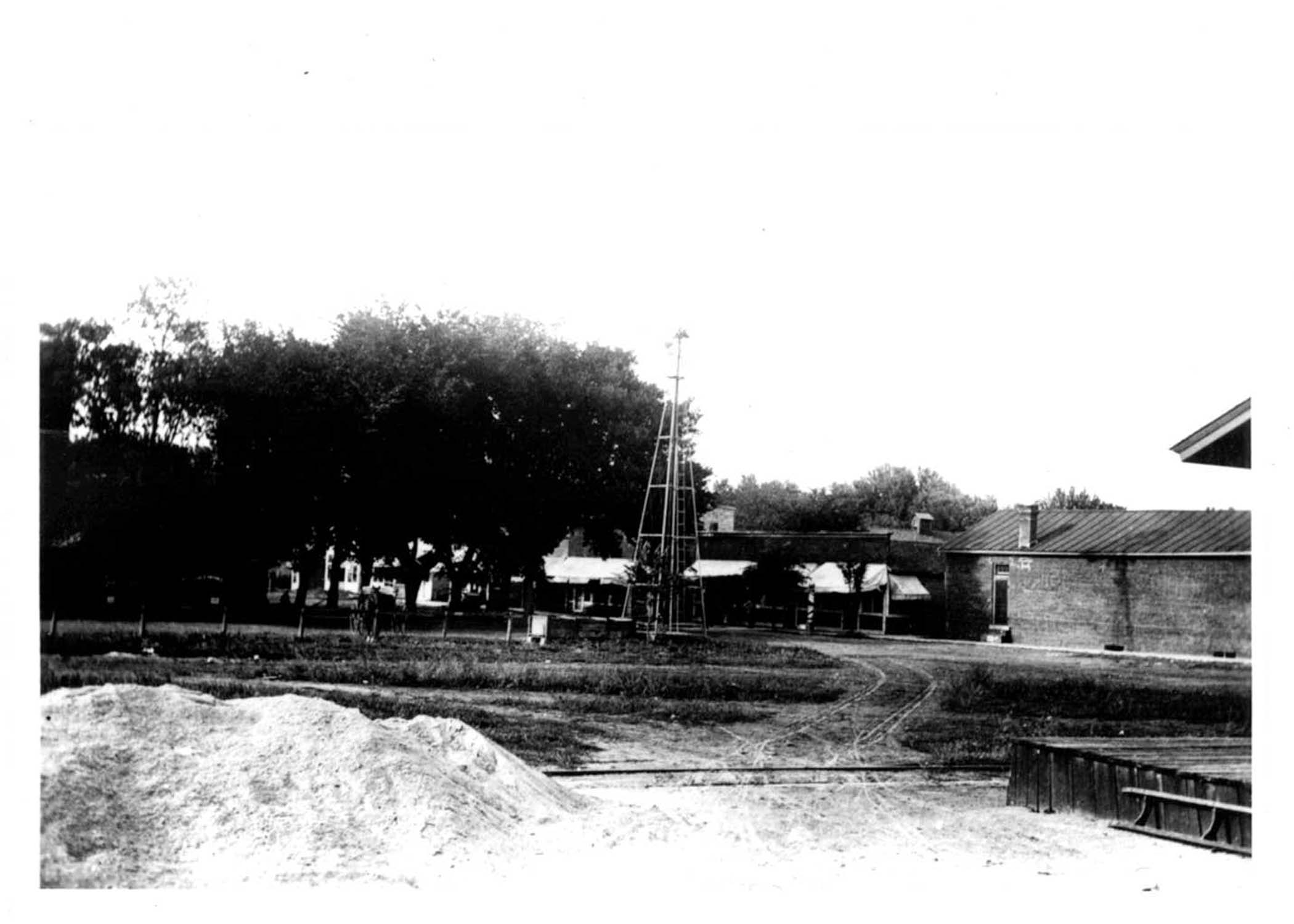 Around 1900, this downtown water well fed horses and filled water tanks.